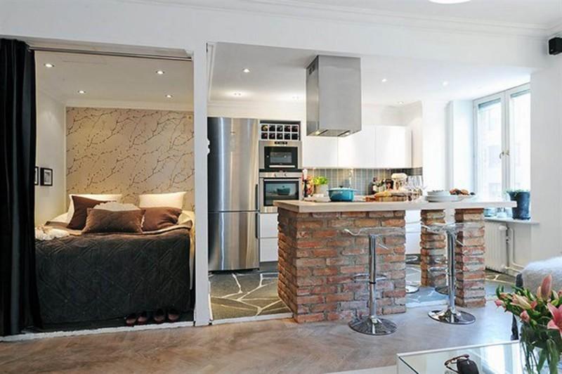 Барная стойка отделяет пространство кухни от гостиной
