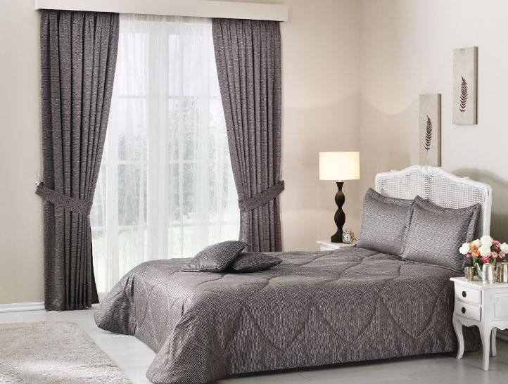 Интерьерный текстиль серого цвета в спальне